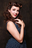 Beautiful Brunette  Pin Up Style Girl in Studio Stock Photography