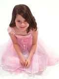 Beautiful Brunette in Pink. Young brunette girl in a pink Spring dress Royalty Free Stock Photos