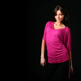Beautiful brunette in pink clothes Royalty Free Stock Images