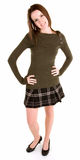 Beautiful Brunette in a Plaid Skirt and Sweater Royalty Free Stock Photos