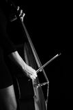 Beautiful brunette playing cello Royalty Free Stock Photo