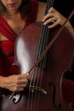 Beautiful brunette playing cello selective light Royalty Free Stock Photo