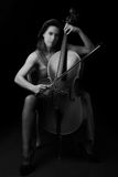 Beautiful brunette playing cello Stock Photos