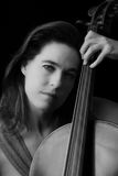 Beautiful brunette playing cello Royalty Free Stock Photos