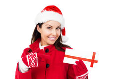 Beautiful brunette pointing a christmas gift Stock Images