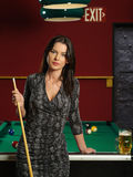 Beautiful brunette at a pool table Royalty Free Stock Photo