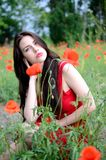 Beautiful brunette with poppies Stock Photo