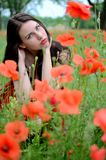 Beautiful brunette with poppies Stock Photos