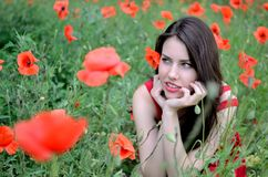 Beautiful brunette with poppies Royalty Free Stock Photography