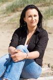 Beautiful brunette portrait on the beach Royalty Free Stock Photo