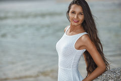 Beautiful brunette portrait on beach Royalty Free Stock Image