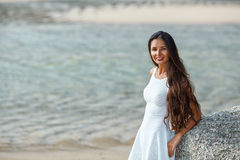 Beautiful brunette portrait on beach Royalty Free Stock Photography