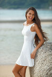 Beautiful brunette portrait on beach Stock Photos