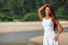 Beautiful brunette portrait on beach Stock Photo