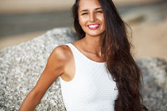 Beautiful brunette portrait on beach Royalty Free Stock Photos