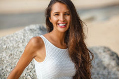 Beautiful brunette portrait on beach Stock Images