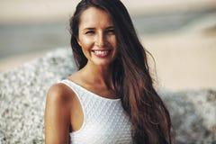 Beautiful brunette portrait on beach Stock Photos