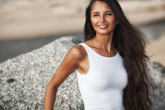 Beautiful brunette portrait on beach Royalty Free Stock Images