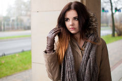 Beautiful brunette portrait in coat Stock Photo