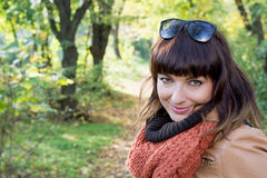 Beautiful brunette posing in autumn park Stock Photos