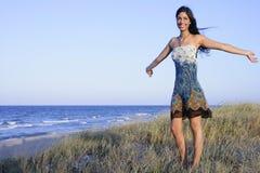 Beautiful brunette posing on the beach Royalty Free Stock Photo