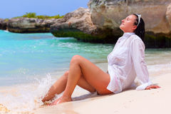Beautiful brunette posing on the beach Royalty Free Stock Image