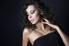 Beautiful brunette posing on black background Royalty Free Stock Photo