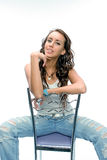 The beautiful brunette posing with a chair Stock Images