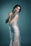 Beautiful brunette posing in elegant evening dress Stock Image