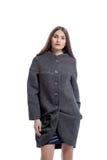 Beautiful brunette posing in gray woolen coat Stock Photography