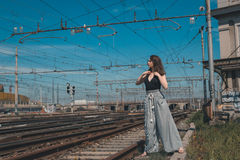 Beautiful brunette posing in an industrial context Stock Image