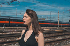 Beautiful brunette posing in an industrial context Stock Photo