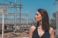 Beautiful brunette posing in an industrial context Royalty Free Stock Photos