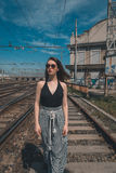 Beautiful brunette posing in an industrial context Stock Photos