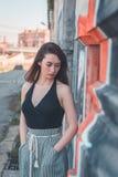 Beautiful brunette posing in an industrial context Stock Photos