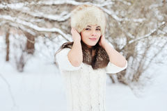 Beautiful brunette posing outdoors in winter Stock Photography