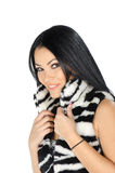 Beautiful brunette posing and showing her furry vest Stock Photo