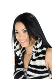 Beautiful brunette posing and showing her furry vest Royalty Free Stock Photography