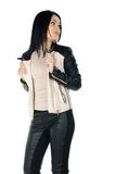 Beautiful brunette posing and showing her leather coat Royalty Free Stock Photo