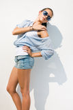 Beautiful brunette posing in summer sunshine. Royalty Free Stock Photos