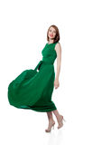 Beautiful brunette posing in trendy green dress Royalty Free Stock Photography