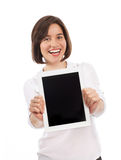 Beautiful brunette presenting a digital tablet Royalty Free Stock Image