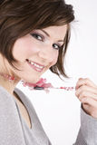 Beautiful Brunette, Pretty Smile. Beautiful brunette woman in casual clothes holding her necklace and smiling for the camera royalty free stock image
