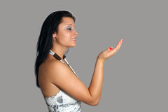 Beautiful Brunette Profile with Hand Raised Stock Photo