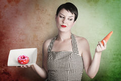 Beautiful brunette questioning her diet Royalty Free Stock Photography