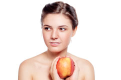 Beautiful  brunette with the red apple Royalty Free Stock Image