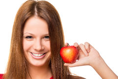 Beautiful brunette with red apple Stock Images