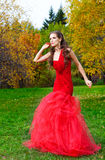 A beautiful brunette in red dress Stock Photo