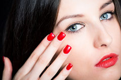 Beautiful brunette with red nails Royalty Free Stock Photography