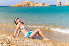 Beautiful brunette at relaxation on the beach Royalty Free Stock Photography